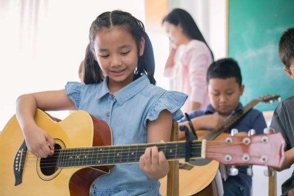 why your kids should learn a musical instrument